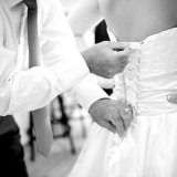 "This is the first time I""ve seen the father of the bride lacing up the wedding dress..."