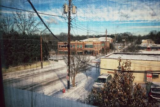 Snowy scene from dirty window